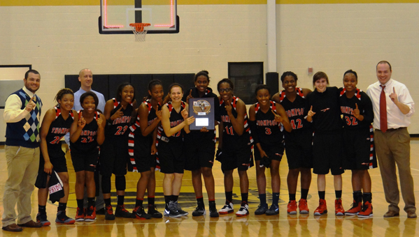 The Thompson Warriors girls basketball team captured the AHSAA Class 6A, Area 7 championship on Feb. 8. The Warriors travelled to Wetumpka, where they upended the Indians 41-34. They now move on to take on Oak Mountain in the sub-region finals. (Contributed/Melissa Black)