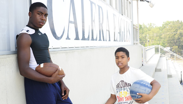 Calera brothers Ty, left and J.J. Evans use sports to overcome the loss of their father and carry on his legacy. (Reporter Photo/Jon Goering)