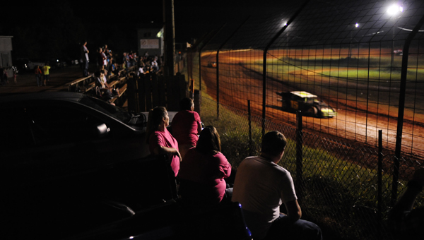 Fans sit and watch from tailgates as the the open-wheel modified division races by. (Reporter Photo/Drew Granthum)