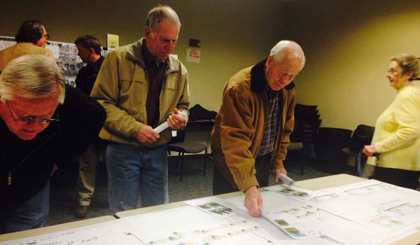 During the meeting, project information and maps were available to the public. (Ginny Cooper/ For the Reporter)