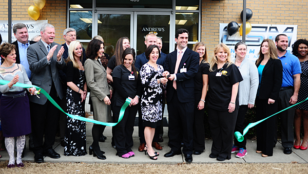 Andrews Sports Medicine physicians, Greater Shelby County Chamber of Commerce representatives and city officials celebrate Andrews Sports Medicine's newest location in Pelham. (Reporter Photo/Jon Goering)