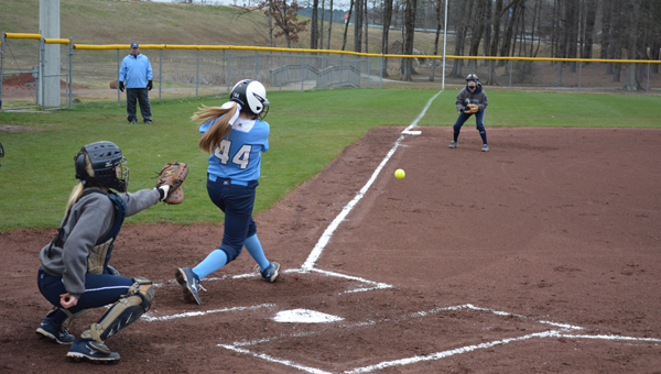 Calera's Charley Clark drives a ball down the third base line in a 17-7 win over Jemison March 4. (Contributed/Candace Roberson)
