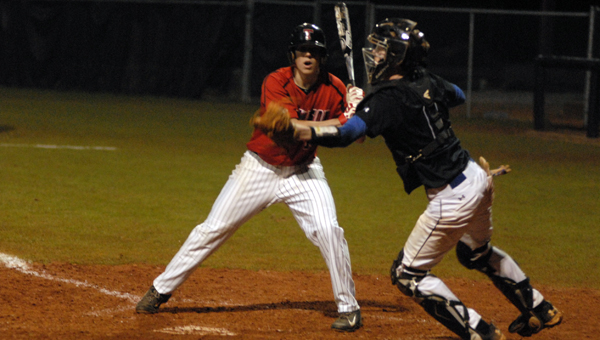 Chelsea catcher Hunter Howard attempts to throw out a runner in a March 5 game against Thompson. (Reporter Photo/Drew Granthum)