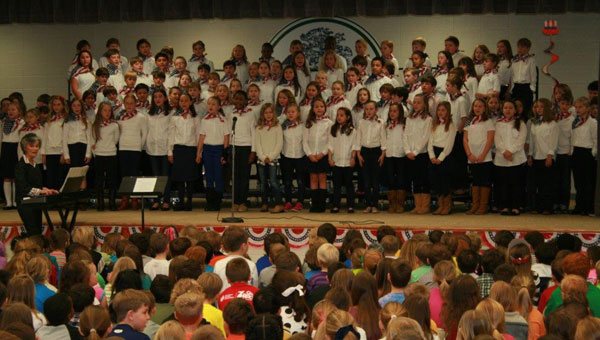 Forth grade students at Forest Oaks Elementary perform in patriotic assembly. (contributed)