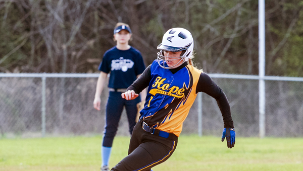 Hope's Samantha Rowley rounds third in a 10-1 loss to Evangel March 22. (Contributed/Twanna Arnold)