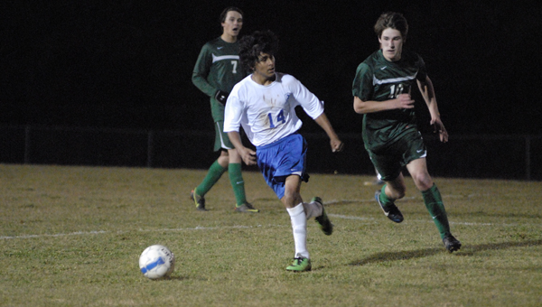 Jose Manduanjo Ortega eludes a Holtville attacker in a March 18 match. The Bulldogs won, 3-1. (Reporter Photo/Drew Granthum)