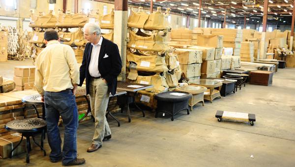 Caleb Davis and Summer Classics CEO, Bew White examine furniture in the warehouse of the nearly 500,000-square-foot Summer Classics headquarters off U.S. 31 in Pelham. (File)