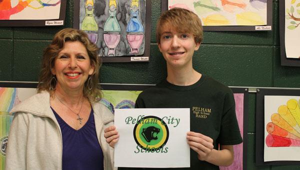 PHS art teacher Kim Harrison and her student, sophomore Jake Nelson, display his award-winning logo creation. (Contributed)