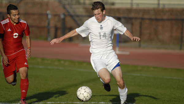 Briarwood's Andy Ball dribbles in on a Collinsville defender in a March 27 match. (Reporter Photo/Drew Granthum)