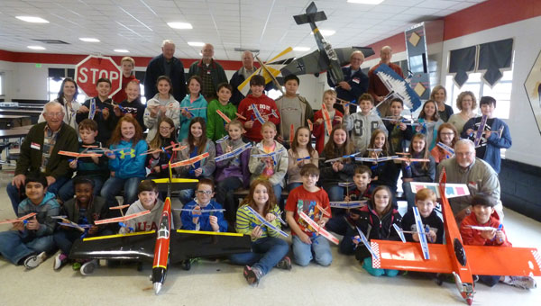 TMS fifth grade gifted students, teachers Susan Mitchell, Rita Sparks, and Nicole Naro, and ARCA members Jim Pappas, Jim Reining, Jonny Williams, Danny McDevitt, Red Robinson, Leslie Harrison and Larry Graves at TMS after students made their model airplanes. (Contributed)