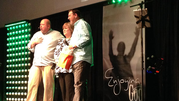 Greg Davis, left, pastor of The Connnection with David and Dianne Rogers, pastor of The Master's House, announce their cooperation. (Contributed)