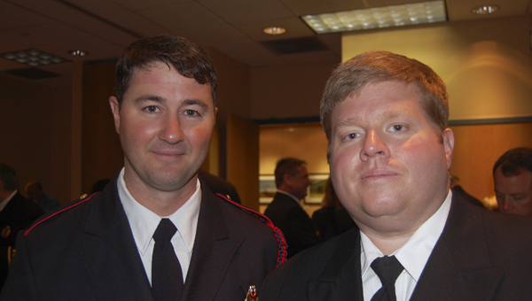 Hoover Fire Department Medic Steven Scoggins and Lt. John Craddock are pictured at a reception following the HFD's Promotion & Awards Ceremony held March 21 at the Hoover Public Library (Reporter Photo/Cassandra Mickens)