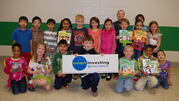 Ms. Haines's first grade class wins the Bank on Books challenge for a third year in a row.