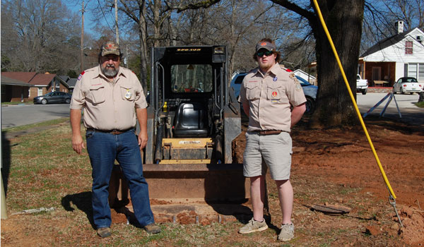 Randall Hunt with troop leader Sid Wheeler at the construction site (Ginny Cooper/ For the Reporter).