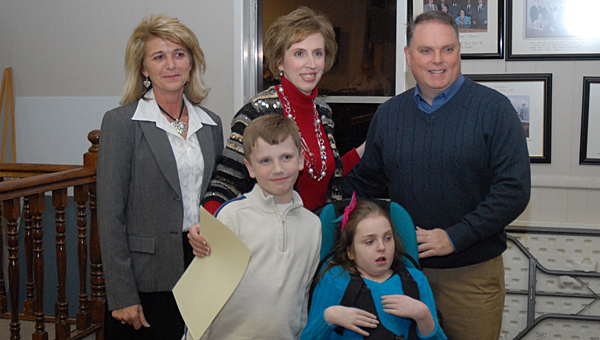 From left, Alabaster Mayor Marty Handlon, Matthew, Drew Ann, Caroline and David Long shortly after Handlon presented a proclamation honoring the family. (Reporter Photo/Neal Wagner)