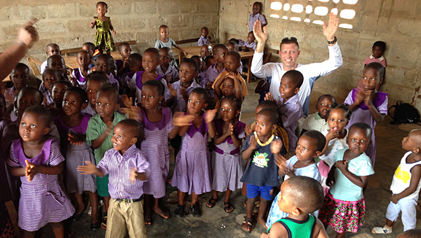 Pelham resident Craig Sorensen, back right, celebrates with children served by a new water distribution system in Ghana, Africa. (Contributed)