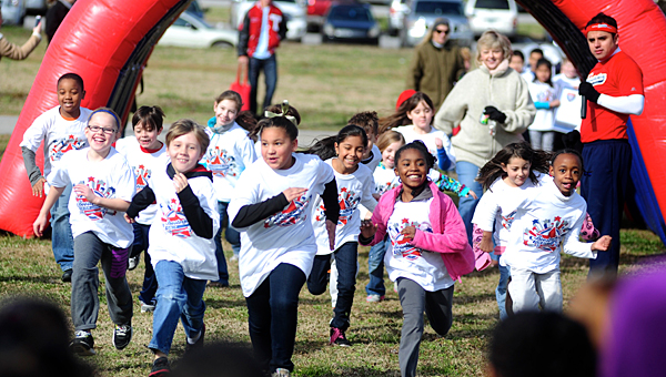 Students participate in a 2013 run at a local school. Shelby County recently was named the healthiest county in the state, posting state-high numbers in nearly every category. (File)