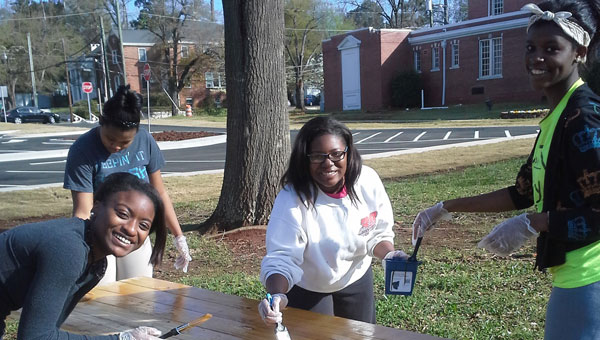 From left, freshman Aania Cox and sophomores Monisha Gresham, Makayla Cottingham and Tajhmin Farrington volunteering at MHS's Day of Service. (Contributed)
