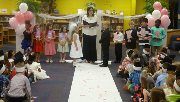 Bride U Katelyn Keef married Groom Q Cooper Pennington by Reading Coach Amy Rucker at Elvin Hill Elementary Scholl's Library. Bridesmaids were a Bailey Lee, e Adilynn Bulger, i Ava Barco and o Brooklyn Oliver. Groomsmen ere A Sam Poe; E Ethan Long; I Damian Stafford and O Jaye' Loum Kelow. (Contributed)