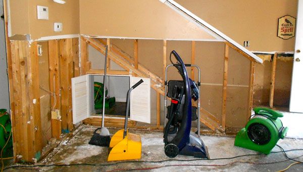 Workers have had to remove water damaged wall from the ground floor of Kim McTune and Heather Delander's townhome after the April 7 flooding. (Reporter Photo / Molly Davidson)