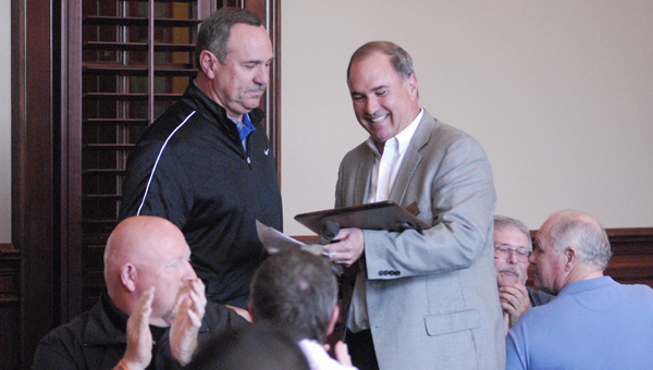 Former Calera head basketball coach Robert Burdette (left) accepts an award from the Calera Chamber of Commerce on April 15. (Reporter Photo/Drew Granthum)