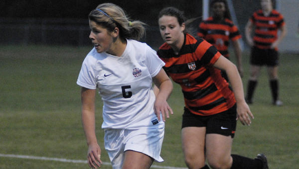 Oak Mountain's Alexandra Dunn dribbles upfield against Hoover April 17. Dunn posted three goals in the 4-1 win. (Reporter Photo/Drew Granthum)