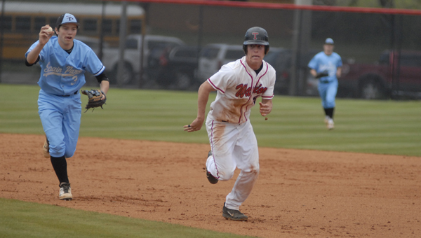 Thompson's Davis Cox tries to outrun a pickle play while Spain Park's Alan Desantis gives chase in an April 19 playoff matchup. (Reporter Photo/Drew Granthum)
