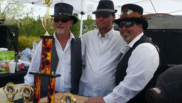 """Two Fat Men and a Grill, a team from Childersburg, this year's Fire in the Foot Hills Grand-Champion of Bar-B-Q: """"We do about five or six of these events every year. We search on the internet all across the country and look for events that look like a lot of fun. We love to interact with the community. We had a blast here today."""" (Contributed)"""