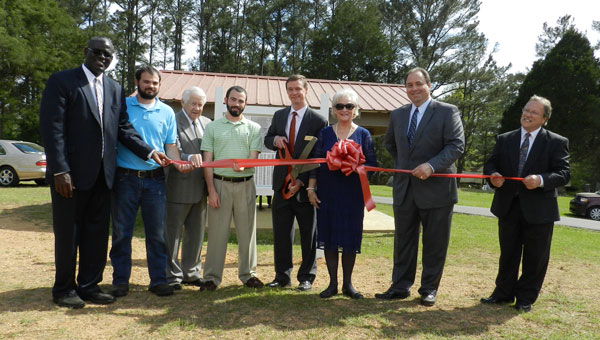 From left, LDS Bessemer Stake President Peter Johnson, Andrew Justice who built the pavilion for his Eagle Scout project, LDS Columbiana ward member Clem Muck, Robert Justice who mapped the graves with GPS system as his Eagle project, LDS member Ricky Harmon, Columbiana City Council member Ouida Mayfield, former Columbiana Mayor Allan Lowe and LDS member George Sippola who created the gridded system and map. (Contributed)