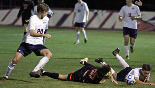 Oak Mountain's Keegan McQueen reacts to a loose ball in a 2-1 win over Hoover April 3. (Contributed/Len Louis)