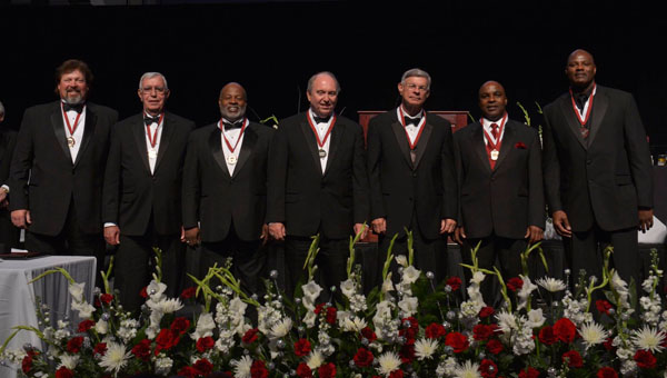 Pelham Board of Education president Rick Rhoades, third from right, was inducted into the Troy University Athletic Hall of Fame on March 29. (Contributed / Troy University Athletics)