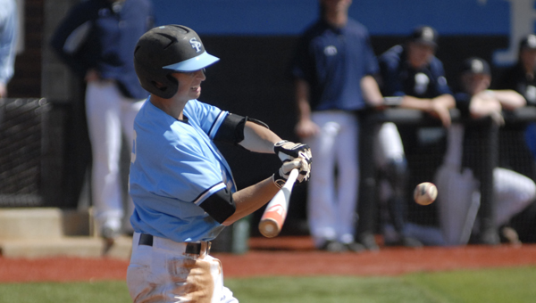 Spain Park's Matt Berler connects with a pitch in an April 5 win over Briarwood. (Reporter Photo/Drew Granthum)