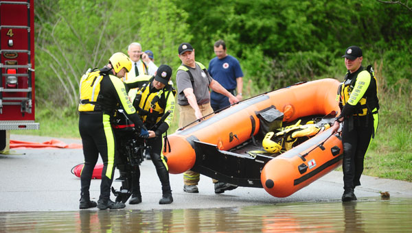 Rescue teams launched a boat into flood waters at Chandalar Drive. Two Humvees and three boats continue to carry out water rescues in the severly flooded neighborhood. (Reporter Photo / Jon Goering)