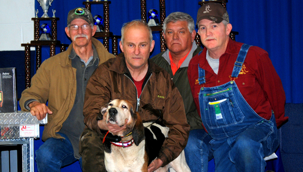 Keith Durkee (center), of Shelby, poses with his hunting teammate Mo and officials from the American Kennel Club Coonhound Events after capturing the 2014 World Coonhunting Championship on March 1. (AKC/Caroline Murphy)