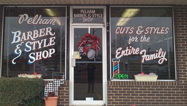 Pelham Barber and Style Shop owner Donna Catrett celebrated 30 years in business on April 4. She has owned the barbershop on Pelham Parkway since 1984. (Contributed)