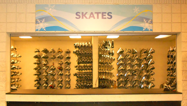 Brand new skates line the walls of the Pelham Civic Complex skate rental booth, just one of the many changes Civic Complex Director, Danny Tate, has made to improve the facility. (Reporter Photo / Molly Davidson)