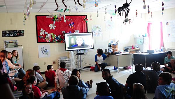 Students in Nerissa DeRamus' biology class at Thompson High School Skypes with HudsonAlpha scientist Jennifer Carden on April 25. (Reporter Photo/Jon Goering)