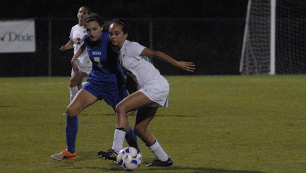Chelsea's Sophie WIlson (No. 7) battles a Thompson defender in an April 2 matchup. (Reporter Photo/Drew Granthum)