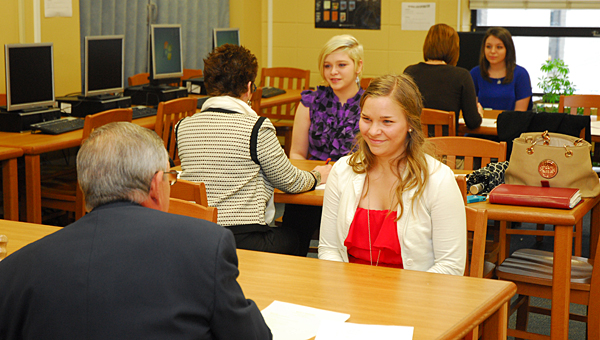 Local elected officials, business leaders and Shelby County School System representatives conduct mock interviews with Vincent Middle High School students at the school on April 18. (Reporter Photo/Neal Wagner)