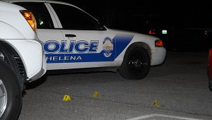 Evidence markers identify shell casings in the Papa Saia's parking lot on April 19. (Reporter Photo/Neal Wagner)