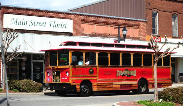 The Columbiana trolley rolls down Main Street in Columbiana on April 1. (Reporter Photo/Jon Goering)