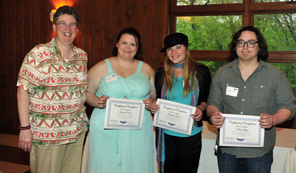 Juvenile Detention Facility Director Debra RouLaine with her Falcon Scholars Amanda Currie, Charitina Goebel and Nathan Glaze (Contributed)
