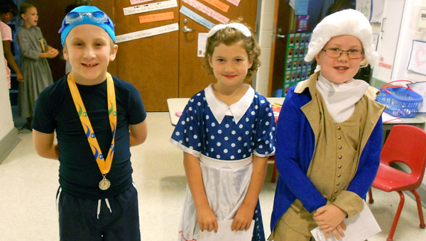 Helena Elementary School second graders dressed as Michael Phelps, Lucille Ball and Thomas Jefferson got ready to present to parents, teacher and students during the May 6 production of the Living Museum. (Reporter Photo / Molly Davidson)