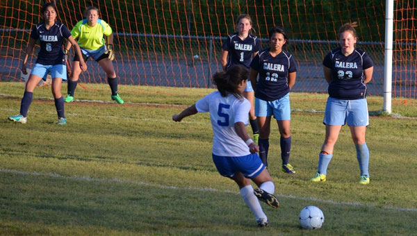 Senior Montevallo High School striker Lupe Serrano kicks for a goal against Calera in the first round of the sub-state playoffs. (Contributed)