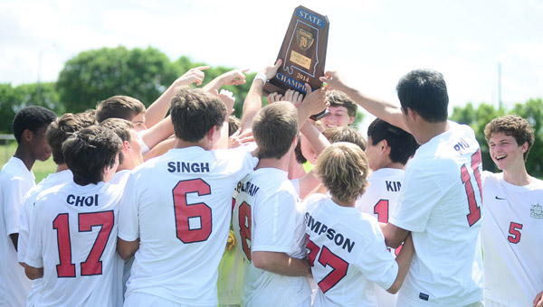 The Indian Springs School's boys soccer team celebrates winning the 2014 AHSAA Class 1A-4A state championship. (Reporter Photo/Jon Goering)