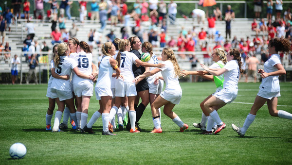 Members of Oak Mountain's girls team celebrate after capturing the AHSAA Class 6A soccer state championship. (Reporter Photo/Jon Goering)