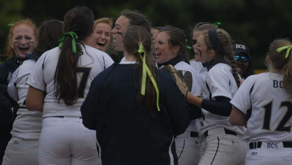 Members of Briarwood's softball team celebrate the program's first win at the AHSAA state softball championships May 15. (Reporter Photo/Drew Granthum)