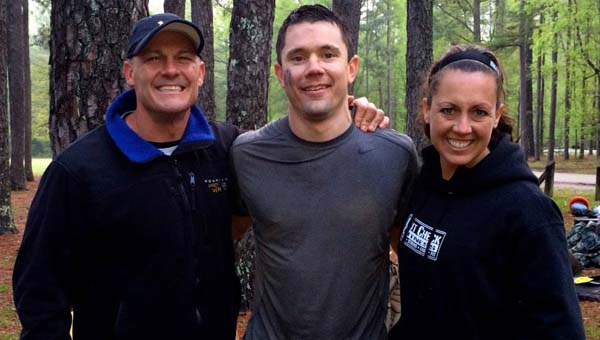 """Jeremiah Rogers, center, winner of the Southeast """"The Suck,"""" helad at Oak Mountain State Park April 18, with Joe and Nicole Decker, organizers of the events and owners of Gut Check Fitness of San Diego. (Contributed)"""