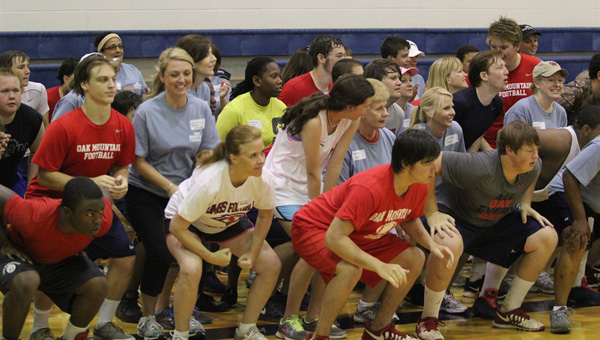 The Oak Mountain football squad celebrated a collective Mother's Day May 10, as members of the team hosted their moms to a clinic on football.  The mothers learned about equipment, positions on the field, strategy and were able to run through warm-ups and drills with their sons. (Contributed)