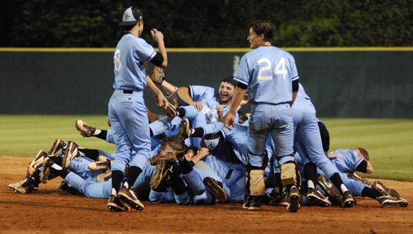 Members of Spain Park's baseball team celebrate after taking a win in the opening game of the AHSAA Class 6A state championship series. (Reporter Photo/Drew Granthum)